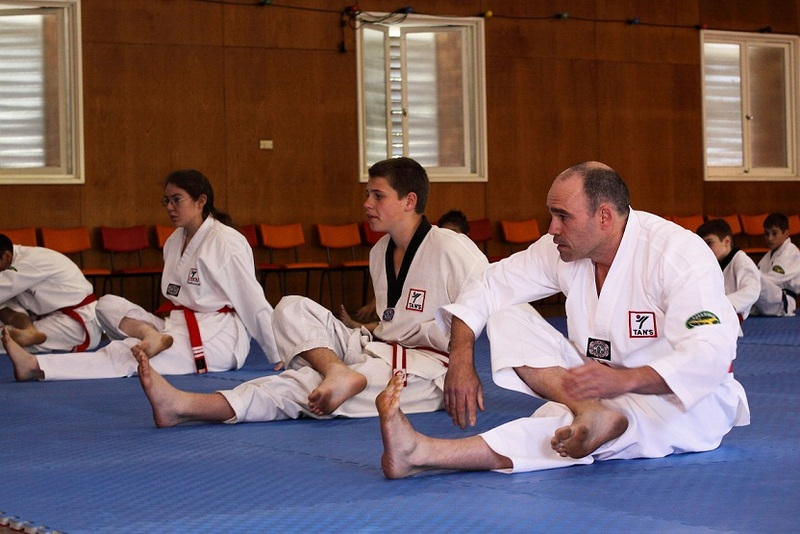 Leigh stretching in a taekwondo class